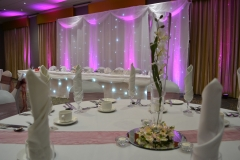 Uplighting_twinkling_starlight_curtain_backdrop_led_centrepieces_chair_covers_sashes