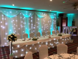 uplighting-rose-trees-twinkling-led-backdrop-star-light-curtain-top-table-skirt-love-letters-wedding-breakfast