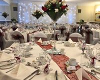 Chair-covers-sashes-twinkling-backdrop-top-table-skirt-cake-skirt
