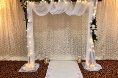 rustic-wedding-arch-romantic-floral-candles-ceremony-voiles-swags-wooden-flowers-chair-covers-backdrop