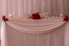 swagging-sweet-heart-table-bride-groom