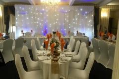 twinkling-backdrop-blue-uplighting-wedding-breakfast-rustic-theme