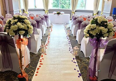 Aisle_runner_white_carpet_rose_trees_chair_covers_sashes_rose_petals_lantersn_ceremony_decor.JPG