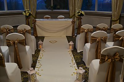 aisle_decoration_lanterns_cream_ceremony_carpet_chair_covers_sashes.JPG