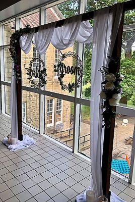 bride-groom-wedding-arch-swagging-lanterns.jpg