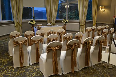 chair_covers_satin_sashes_ceremony_decoration_aisle_lanterns_rose_trees.JPG