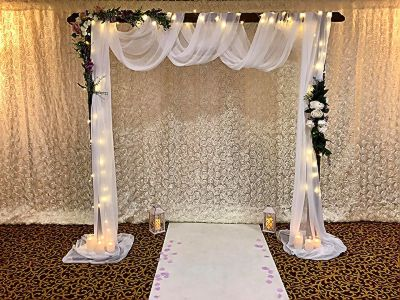 rustic-wedding-arch-romantic-floral-candles-ceremony-voiles-swags-wooden-flowers-chair-covers-backdrop.jpeg