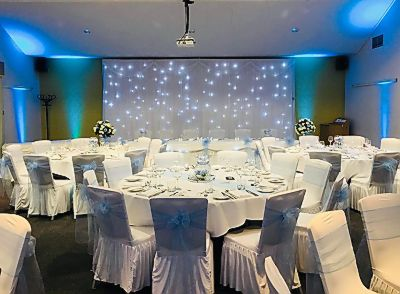 twinkling-Led-backdrop-uplighting-top-table-skirt.jpg