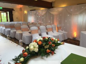 ceremony-aisle-runner-flowers-rose-trees-chair-covers-sashes-backdrops-twinkling-led-star-curtain-petals-lanterns