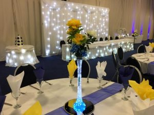 wedding-breakfast-twinkling-top-table-skirt-backdrop-starcurtain-led-centrepieces-chair covers